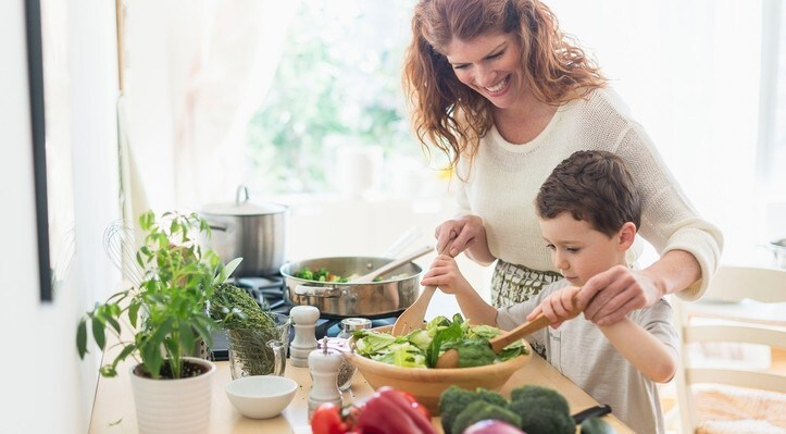 Mother and son preparing healthy meal full of foods with vitamin E